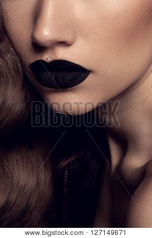 Beauty Black Lip Makeup Beauty Fashion Model Girl with Black Make up Long Lushes. Fashion Trendy Caviar Black Manicure.