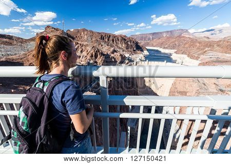 LAS VEGAS, NEVADA - SEPTEMBER 6, 2015: Girl in front of Hoover Dam and Lake Mead