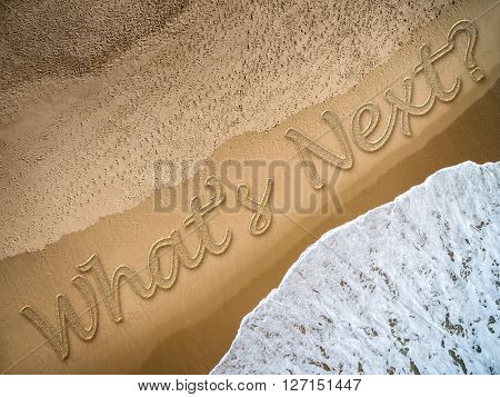 Whats Next? written on the beach