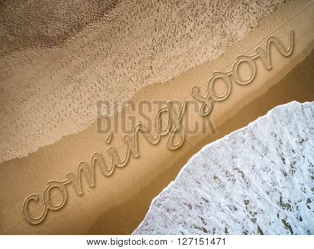 Coming Soon written on the beach