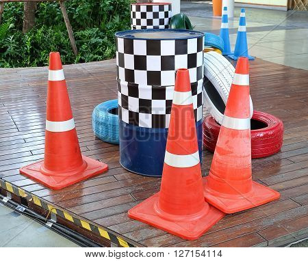 Automotive Safety Concepts Painted Tires with Orange Traffic Cones and Traffic Barrels.