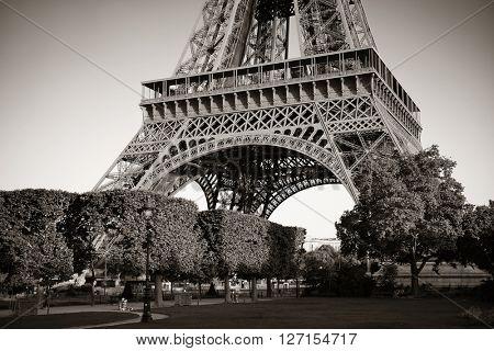 Eiffel Tower closeup in park as the famous city landmark in Paris