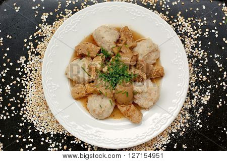 Goulash With Oyster Mushroom And Buckwheat Dumplings On The Black Background