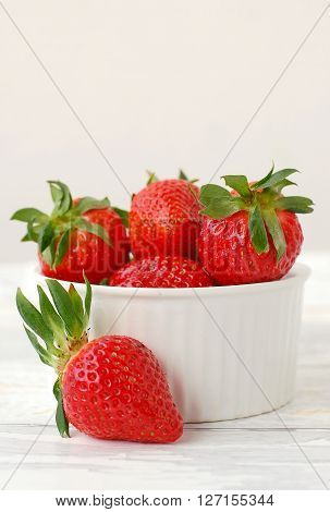 Strawberries On The Wooden Background