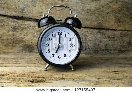 Morning alarm clock on table, alarm time