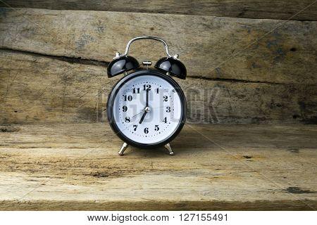 Morning alarm clock on table, analog, metal, wooden