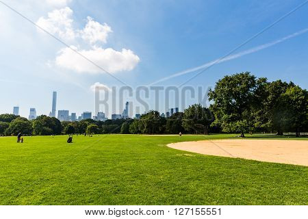 NEW YORK - SEPTEMBER 19, 2015: Views of the from the big meadow Central Park to Midtown New York on September 19, 2015. The Central Park is a famous Park in the centre of Manhattan New York.