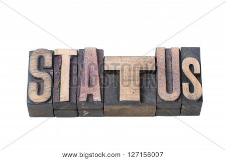 status word made from vintage wooden letterpress type isolated on white