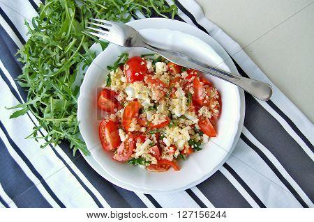 Salad With Arugula, Tomato, Quinoa And Cheese