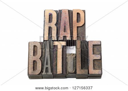 rap battle phrase made from vintage wooden letterpress type isolated on white