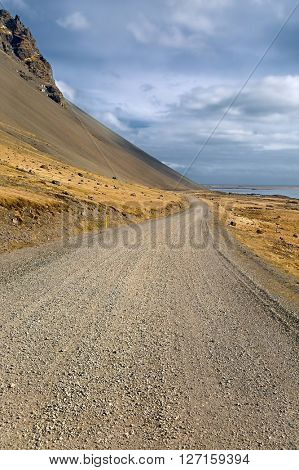 Gravel road leading to the distance