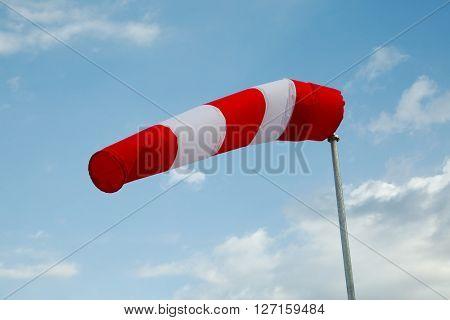 Wind sock against clear blue sky