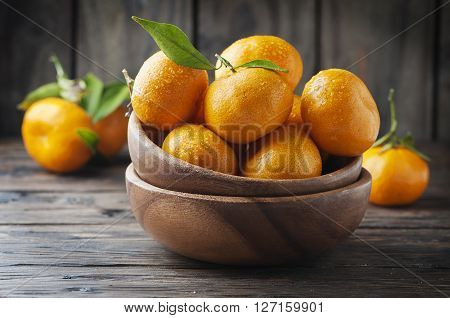 Sweet Fresh Mandarin On The Wooden Table