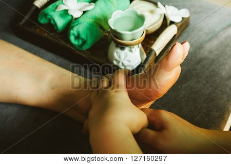Close-up of female hands doing foot massage,Shallow depth of field with focus on foot,selective focus.