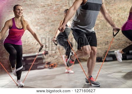 Group of people doing workout  with resistance band