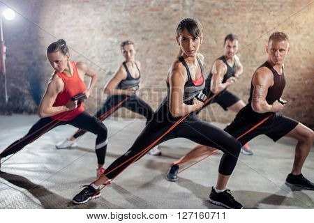 Group of healthy people on group training with resistance band