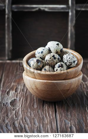 Raw Quail Eggs On The Wooden Table
