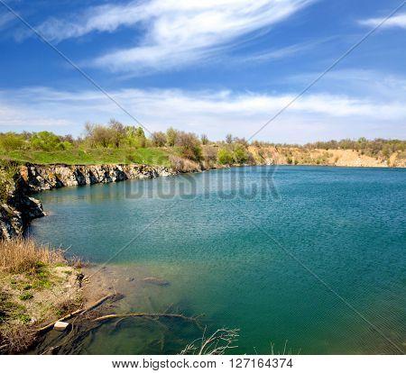 Nice scene with lake under spring sky