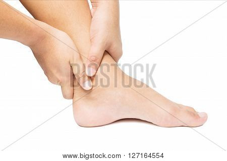 Acute pain in ankle. hand massage ankle isolated white background