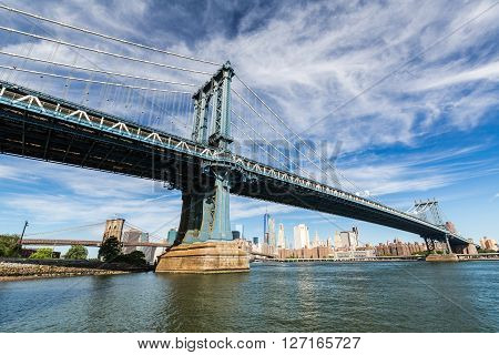 NEW YORK, USA - AUGUST 22, 2015: Views of the Manhattan Bridge on a summer day on August 22 2015. Its a famous and iconic bridge in New York which passes the east river.
