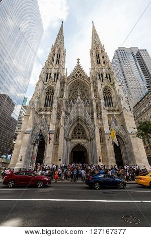 NEW YORK, USA - SEPTEMBER 19, 2015: View to the St. Patricks Cathedral in Midtown Manhattan with the famous 5th Avenue on SEPTEMBER 19 2015. Its a decorated Neo-Gothic-style Roman Catholic cathedral church.