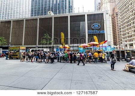 NEW YORK - AUGUST 23, 2015: Views to the fast food stands at the Fifth Avenue New York on August 23, 2015. Fast food stands are very popular in Manhattan New York.