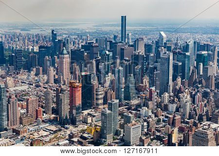 NEW YORK, USA - AUGUST 24, 2015: Views of Midtown Manhattan from a helicopter in New York on August 24 2015. Helicopter tours are popular by tourist in New York.