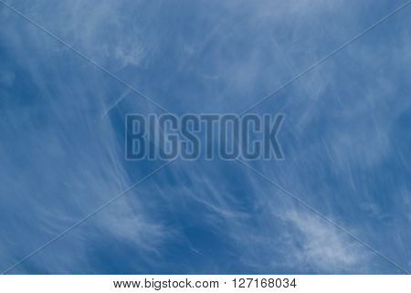 Photo of deep blue sky with cirrus clouds