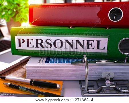 Green Ring Binder with Inscription Personnel on Background of Working Table with Office Supplies and Laptop. Personnel Business Concept on Blurred Background. 3D Render.