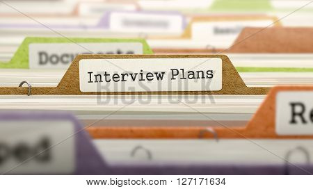 Interview Plans Concept on Folder Register in Multicolor Card Index. Closeup View. Selective Focus. 3D Render.