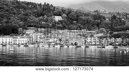 TOSCOLANO MADERNO (BS), ITALY - APRIL 25, 2016:  view of the village of Toscolano Maderno, along the shores of Garda Lake (Lombardy, Northern Italy), early springtime. Black and white photo