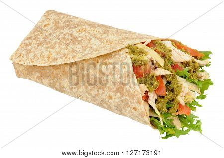 Chicken and salad in a tortilla wrap with basil herb pesto isolated on a white background