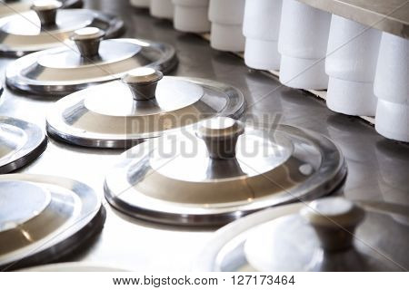 Rows Of Lids On Ice Cream Containers By Cups
