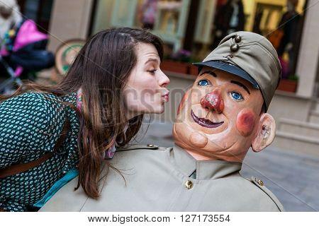 Girl kissing Svejk doll in Czech Rupublic