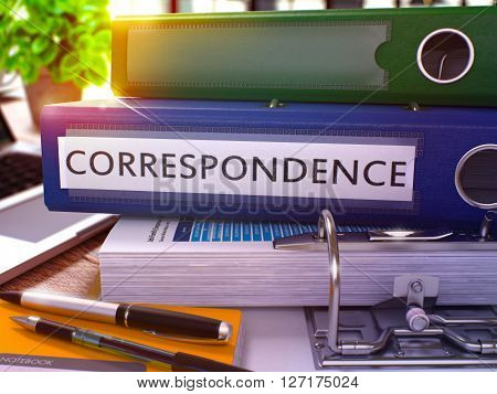 Blue Office Folder with Inscription Correspondence on Office Desktop with Office Supplies and Modern Laptop. Correspondence Business Concept on Blurred Background. Correspondence - Toned Image. 3D.