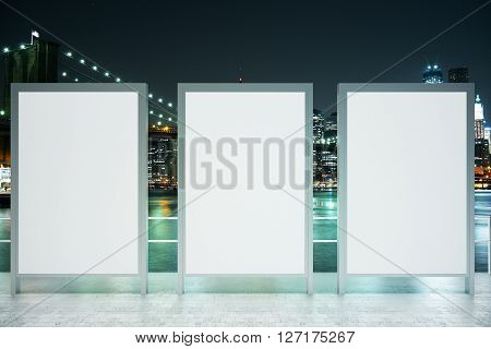 Observation ground with three blank banners on illuminated night city background. Mock up 3D Rendering