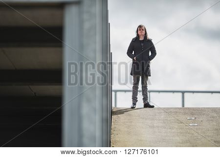 Androgenic Man Standing On Roof Of Parking Garage