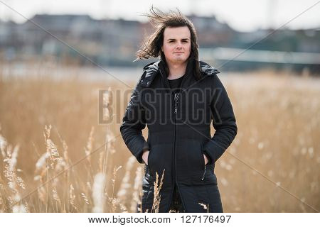 Androgenic Man Between Reed In Residential Area