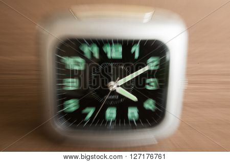 clock blurred - conceptual image of time running or passing away
