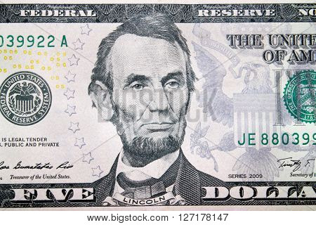 five dollars banknote with image of president