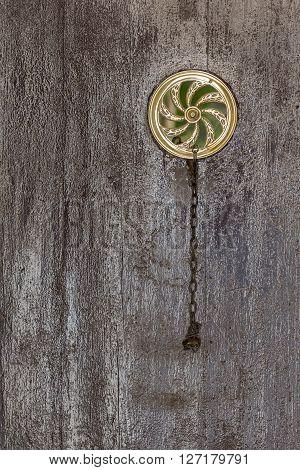 Wooden door vintage peephole, architecture detail. Closeup