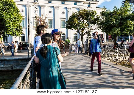 Lucerne, Switzerland - August 2: Tourists Taking Selfie Photographs On Late Afternoon In Lucerne On