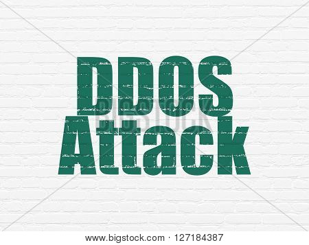 Protection concept: Painted green text DDOS Attack on White Brick wall background