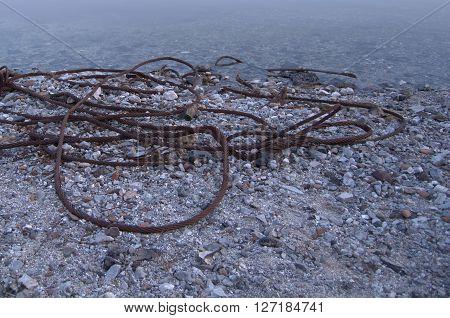 Rusty Steel Wire on Riverside near Water