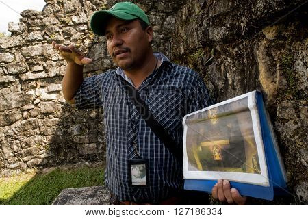 Tour Guide Talks To Tourists At Chiapas In Mexico