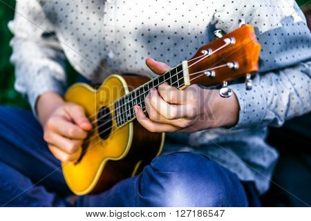 Man playing acoustic guitar close up outdoors. Man playing acoustic guitar close up outdoors