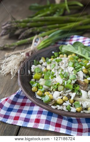 Risotto With Asparagus Spears, Champignon Mushrooms, Green Onion, Green Peas And Arugula