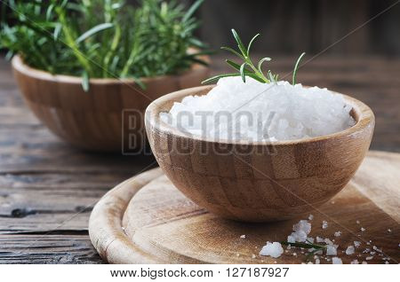 Sea Salt And Green Rosemary On The Wooden Table