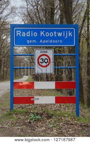 Apeldoorn, Gelderland, The Netherlands -April 25, 2016: City entering sign Radio Kootwijk, Apeldoorn