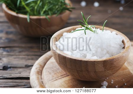 Sea Salt And Fresh Rosemary On The Wooden Table